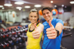 Fit couple smiling at camera. At the gym Royalty Free Stock Images