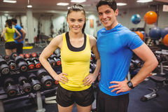 Fit couple smiling at camera Stock Image