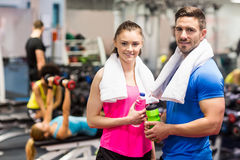 Fit couple smiling at camera. At the gym Stock Photos