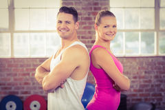 Fit couple smiling in crossfit. Gym Royalty Free Stock Photo