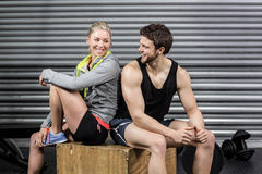 Fit couple smiling at each other Royalty Free Stock Images