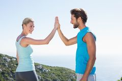 Fit couple standing high fiving Royalty Free Stock Photography