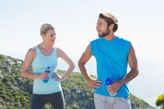 Fit couple standing holding water bottles Stock Photography