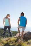 Fit couple standing looking out to sea Stock Image