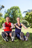 Fit couple stretching in the park Stock Image