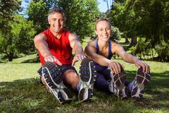 Fit couple stretching in the park Royalty Free Stock Photography