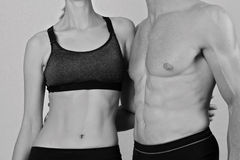 Fit couple, strong muscular man and slim woman . Sport, fitness ,workout concept. Love, togetherness, relationship Stock Photos