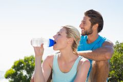 Fit couple taking a break at summit looking at the view Royalty Free Stock Images
