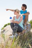 Fit couple taking a break at summit Stock Photography