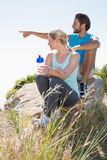 Fit couple taking a break at summit Royalty Free Stock Image