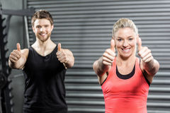Fit couple with thumbs up. At crossfit gym Royalty Free Stock Photo