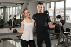 Fit Couple Together Training Biceps With Dumbbells Royalty Free Stock Image