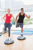 Fit couple working on bosu ball Stock Photography