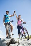 Fit cyclist couple happy to have reached the summit Stock Photos