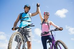 Fit cyclist couple happy to have reached the summit Royalty Free Stock Photo