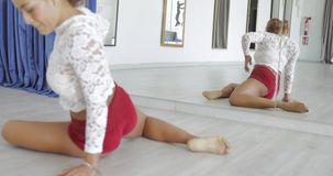 Fit dancer stretching in studio stock footage