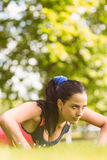 Fit determined brunette doing push ups Stock Images