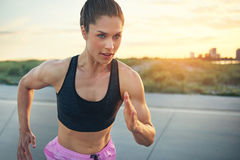 Fit determined young woman runner Stock Image