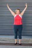 Fit elderly woman doing yoga exercises stock image