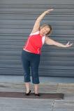 Fit elderly woman doing yoga exercises stock photo