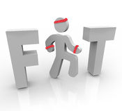 Fit - Exercising Man in Word. A jogging man stands in for the I in the word Fit Royalty Free Stock Image