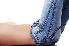 Fit female body in blue jeans. Isolated on white Royalty Free Stock Image