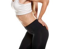 Fit female body. Close up photo of fit muscular body of healthy sportswoman Royalty Free Stock Images