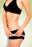 Fit female body - weight loss Royalty Free Stock Photography