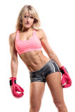 Fit female boxer. Isolated over a white background with a smile on her face Royalty Free Stock Photo