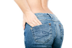 Fit female butt in blue jeans, isolated on white. Torso of topless girl in  blue jeans ,  on white Stock Photo