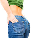 Fit female butt in blue jeans, isolated on white Royalty Free Stock Photography