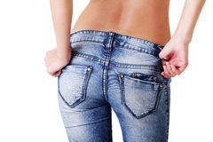 Fit female in jeans Royalty Free Stock Photos