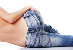 Fit female butt in jeans. Isolated on white Royalty Free Stock Photos