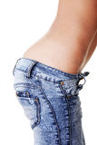 Fit female in jeans Royalty Free Stock Photography