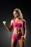 Fit female doing dumbbells exercises Royalty Free Stock Photos