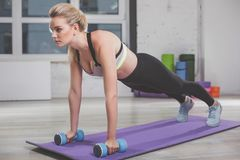 Fit female doing pressing exercises in gym royalty free stock photo
