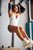 Fit female gymnast performing the strength exercise