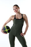 Fit female holding a gym ball. Image of a fitness model posing with a medicine ball Royalty Free Stock Images