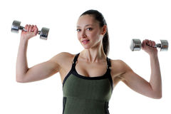 Woman training with weights. Healthy young woman training with weights on a white background Stock Images
