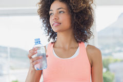 Fit female holding water bottle at gym Royalty Free Stock Photography