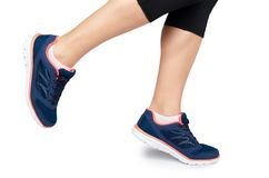 Fit female leg in sport shoe isolated on white background.  stock photo