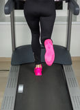 Fit female legs on a treadmill at the gym Royalty Free Stock Photography