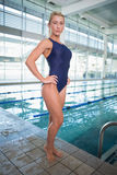 Fit female swimmer by the pool at leisure center Stock Image