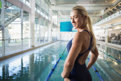 Fit female swimmer by pool at leisure center Royalty Free Stock Photos