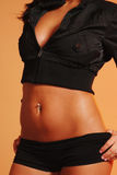 Fit female torso. Sexy female body in a black halter and panties Royalty Free Stock Photos