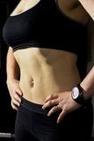 Fit Female tummy in training clothing Stock Images