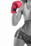 Sexy boxer. A color processed image of a woman wearing sports gear and red boxing glove Stock Photography