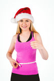 Fit festive young blonde measuring her waist Royalty Free Stock Photography