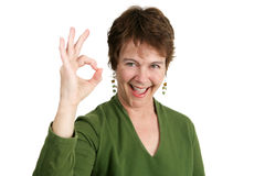 Fit Fifty and A-Okay. An adorable fifty year old Irish woman giving the okay hand sign Royalty Free Stock Image
