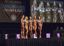Fit Figure Beauties Shine in Vancouver. The top 5 finishers pose at the 2015 IFBB Vancouver Pro/Am & Expo Figure competition on July 26, 2015.  The event was Royalty Free Stock Photo
